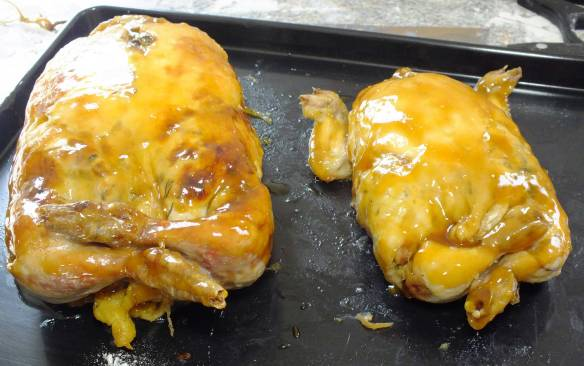 The guinea fowl beside its much smaller Poussin. All glazed being chilled for tomorrows picnic at Penhurst.