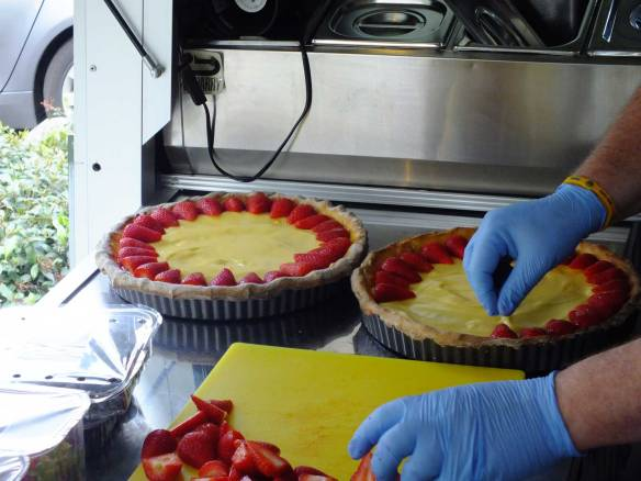 preparing strawberry tart for the party