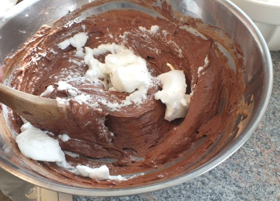Adding egg white to the chocolate, egg yolk and cream mixture